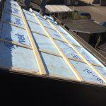 na lekkage dak kapel voorzien van een nieuw dakbeschot panlatten en de oude pannen weer terug geplaatst